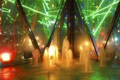 Scenic illumination. Abstract play of night illumination colors in small fountain waters royalty free stock photo