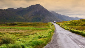 A scenic irish nature landscape with tourist bus Royalty Free Stock Photos