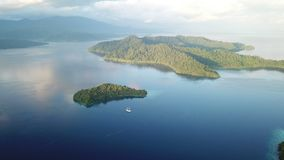 Aerial View of Beautiful Islands in Raja Ampat. The scenic islands in Raja Ampat, are surrounded by healthy, shallow coral reefs. This remote, tropical region is stock video