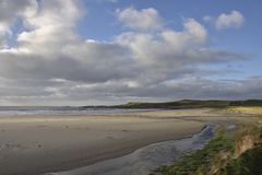 Scenic Islay. View across the beautiful sandy beach of Machir Bay, looking north to Coull Point, a popular haunt of walkers, west Islay, Scotland royalty free stock photography