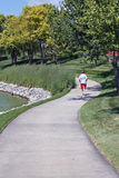 Scenic jogging path with runner. Scenic biking/jogging trail with runner in central Iowa Stock Photos