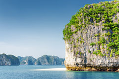 Scenic karst tower-isle and white wild beach in the Ha Long Bay Royalty Free Stock Image
