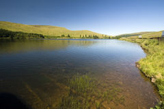 Scenic lake. Quiet waters of a scenic lake at Brecon Beacons National Park, Wales Royalty Free Stock Photography