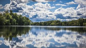 A scenic lake with beautiful clouds and reflections royalty free stock photos