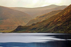 Scenic lake and hill. A serene and peaceful lake with hills in the background Stock Photography