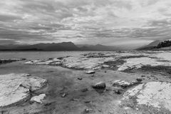 Scenic lake landscape at sunset in black and white. Long exposure stock photos