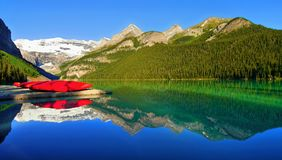 Scenic Lake Louise, Banff National Park, Canada. Scenic view of Lake Louise with boats and mountains in background, Banff National Park, Alberta, Canada Stock Photos