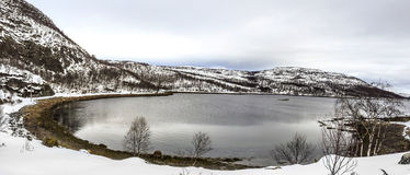 Scenic lake  in Norway and snow covered mountains Royalty Free Stock Images