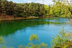 Scenic Lake and Woodlands at the Blue Pool, Dorset, England. Scenic lake and woodland view in Dorset, England. Blue Pool is a flooded, disused clay pit, and the royalty free stock photos