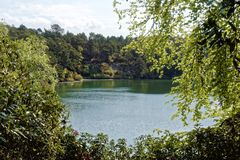 Scenic Lake and Woodlands at the Blue Pool, Dorset, England. Scenic lake and woodland view in Dorset, England. Blue Pool is a flooded, disused clay pit, and the royalty free stock photography