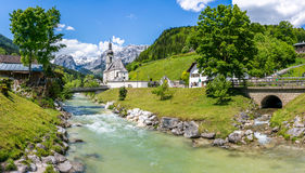 Scenic landscape in the Bavarian Alps in Ramsau, Bavaria, Germany. Scenic mountain landscape in the Bavarian Alps with famous Parish Church of St. Sebastian in Royalty Free Stock Photos