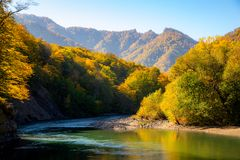 Scenic landscape with beautiful mountain river. Autumn in mountain forest. Sunny day stock photography
