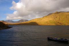 Scenic landscape with boat at connemara in ireland Stock Image