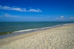 Scenic landscape of calm sea wave on white sandy beach with white cloud and blue sky background. Samila beach, Songkhla, Thailand stock images
