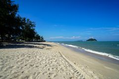 Scenic landscape of calm sea wave on white sandy Sai Kaew beach with small Rat and Cat islands and blue sky background. Samila beach, Songkhla, Thailand royalty free stock images