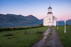 Scenic landscape with church and sunset at summer night Stock Photo