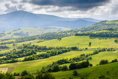 Scenic landscape of the countryside near alpine mountains. Stock Photos