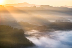 Scenic landscape on foggy hill at sunrise Stock Photo