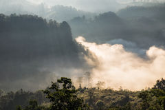 Scenic landscape on foggy valley at sunrise Royalty Free Stock Photo