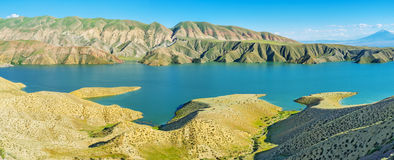 The scenic landscape. The folded mountains and indented banks of Azat Reservoir makes the landscape surreal, Ararat Province, Armenia Stock Photos