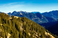 Scenic landscape of forested alpine peaks Stock Photos