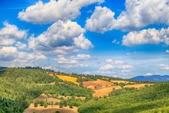 Scenic landscape with green hills and beautiful cloudscape in Tu Royalty Free Stock Image