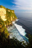 Scenic landscape of high cliff at Uluwatu Temple, Bali, Indonesia Royalty Free Stock Images