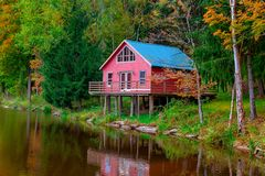 The scenic landscape house by Lake. With reflection in water stock image