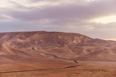 Scenic landscape of magic blue sky and sunrise over judean desert in Israel holy land. Scenic landscape of magic pink sky and sunrise over judean desert in Royalty Free Stock Photography