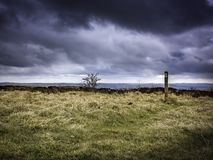 Scenic landscape of Peak District National Park,Derbyshire,Uk. Dramatic,cloudy sky with spells of sunlight in early spring.Landscape Uk,extreme weather Royalty Free Stock Photo
