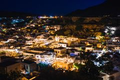 Scenic landscape photo of night Lindos town and castle on Rhodes island, Dodecanese, Greece. Panorama with bright lights, royalty free stock photo