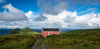 Scenic landscape with a red timber home Stock Images