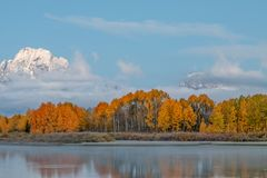 Scenic Autumn Reflection in the Tetons. A scenic landscape reflection in the Tetons in autumn Royalty Free Stock Image