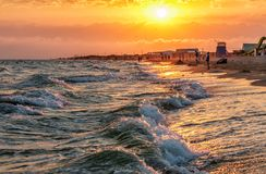 Scenic landscape of sandy Blaga Beach at stormy Black Sea coast with surfing waves breaking on seashore. Summer sunset scenery. Anapa, Russia - July 18, 2016 Royalty Free Stock Photos