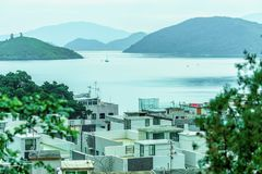 Scenic landscape of Sha Lan villas and Plover Cove at Shuen Wan in Hong Kong. Hong Kong New Territories residential housing view with distant sailboat floating Stock Photography