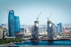 Scenic landscape of skyline Baku with numerous modern high-rise buildings under construction royalty free stock image