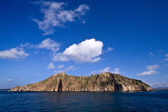 Scenic landscape of small volcanic island with Royalty Free Stock Photos