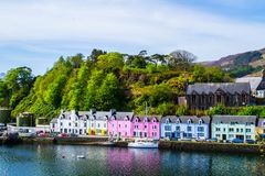 Harbour and colorful building in Potree, Isle Of Skye, Scotland. Scenic landscape view of colorful buildings/houses in harbour of Portree town on Isle Of Skye in royalty free stock photo