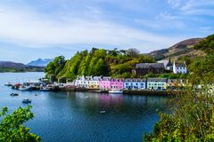 Harbour and colorful building in Potree, Isle Of Skye, Scotland. Scenic landscape view of colorful buildings/houses in harbour of Portree town on Isle Of Skye in royalty free stock photography