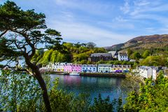 Harbour and colorful building in Potree, Isle Of Skye, Scotland. Scenic landscape view of colorful buildings/houses in harbour of Portree town on Isle Of Skye in stock image
