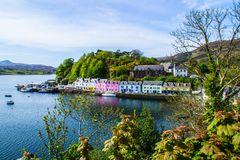 Harbour and colorful building in Potree, Isle Of Skye, Scotland. Scenic landscape view of colorful buildings/houses in harbour of Portree town on Isle Of Skye in royalty free stock image