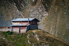 Scenic landscape view at a lonely house at the top of the mountain Transfagarasan, hotel, Romania stock photo