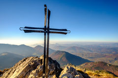 Scenic landscape view of mountain peak with metal cross Stock Photography