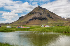 Scenic landscape with village and volcano in Iceland. Royalty Free Stock Photography
