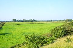 Scenic landscape in Wangerland, Friesland, Lower Saxony, Germany. Scenic landscape in Wangerland, panoramic view over the farmlands in Friesland, Lower Saxony Royalty Free Stock Photography