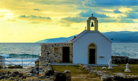 Scenic landscape with white church and aegean sea at sunset, Crete, Greece. Stock Images