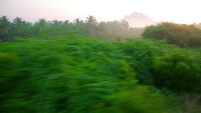 Scenic landscapes from train window stock video footage