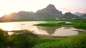 Scenic landscapes from train window stock footage