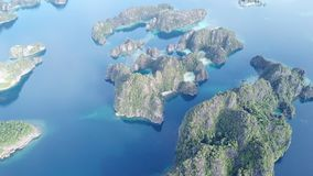 Aerial View of Scenic Islands in Misool, Raja Ampat. The scenic limestone islands in Misool, Raja Ampat, are surrounded by healthy, shallow coral reefs. This stock video