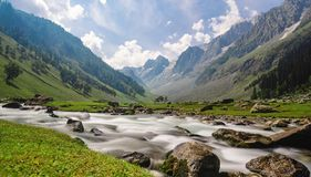 Scenic long exposure water flowing in river with mountain landscape in Sonamarg, Jammu and Kashmir, India. Scenic long exposure water flowing in river with stock images